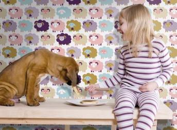 little girl feeding pancakes to her dog